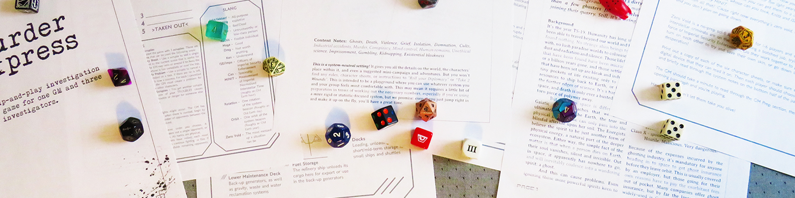 Dice and printed game sheets on a grey background